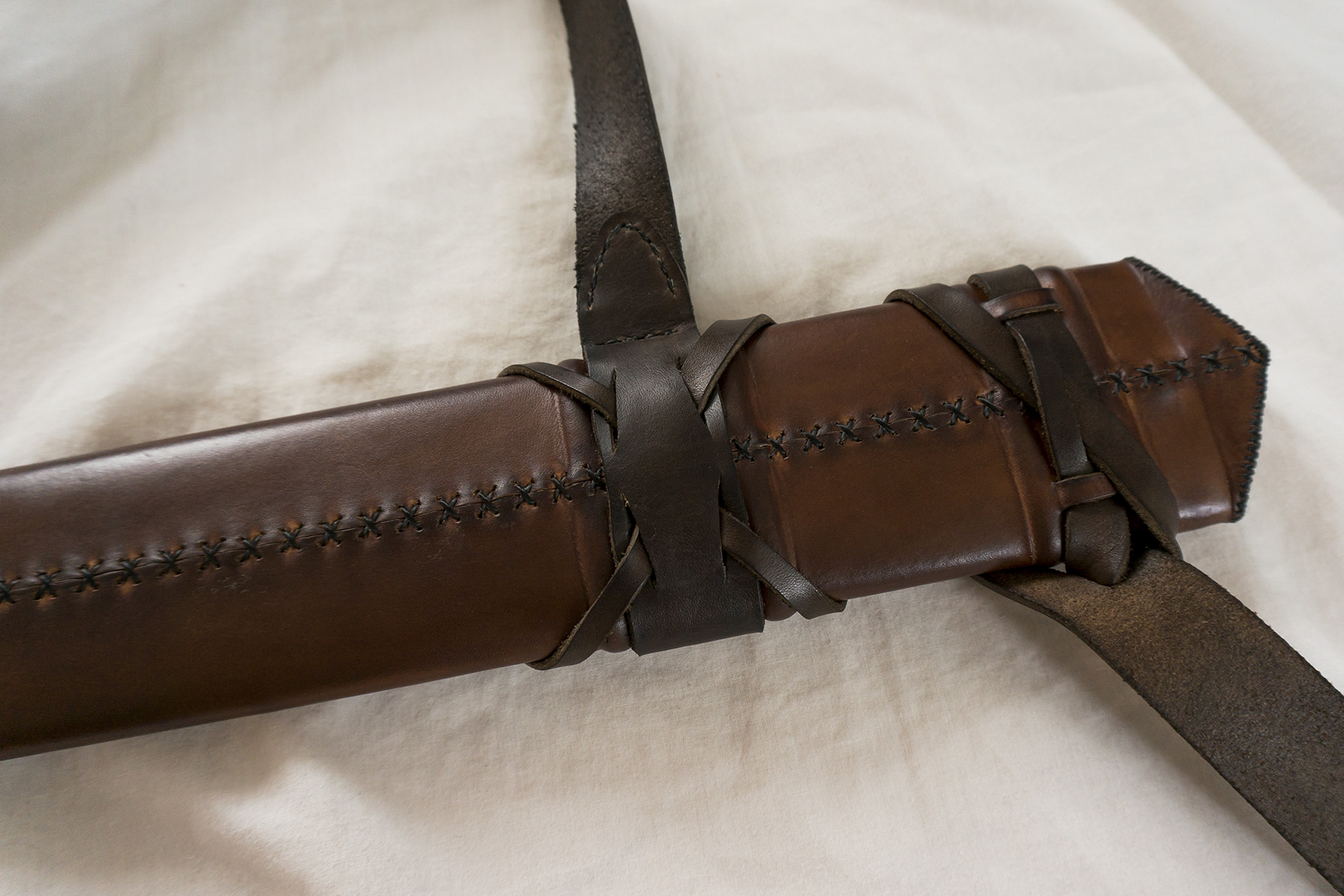 leatherwork leather woodwork wood ash medieval sword scabbard stitching sewing handmade